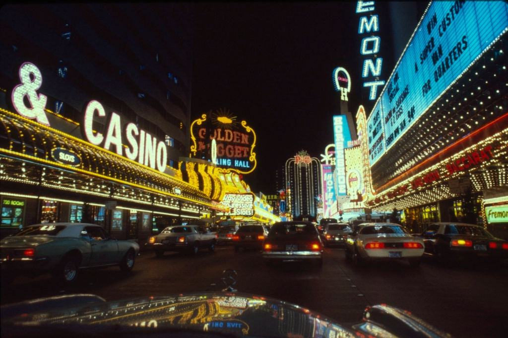 Nighttime view, looking east, of hotels and casinos on Fremont Street, Las Vegas, 1983.