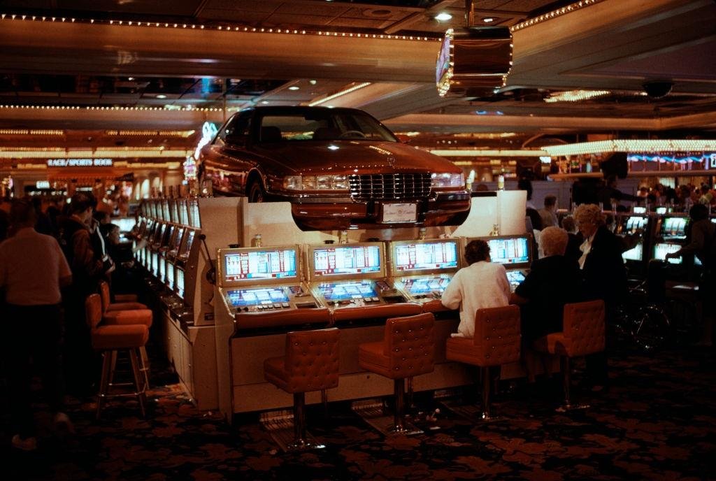Car and slot machines inside a casino in Las Vegas, 1984.