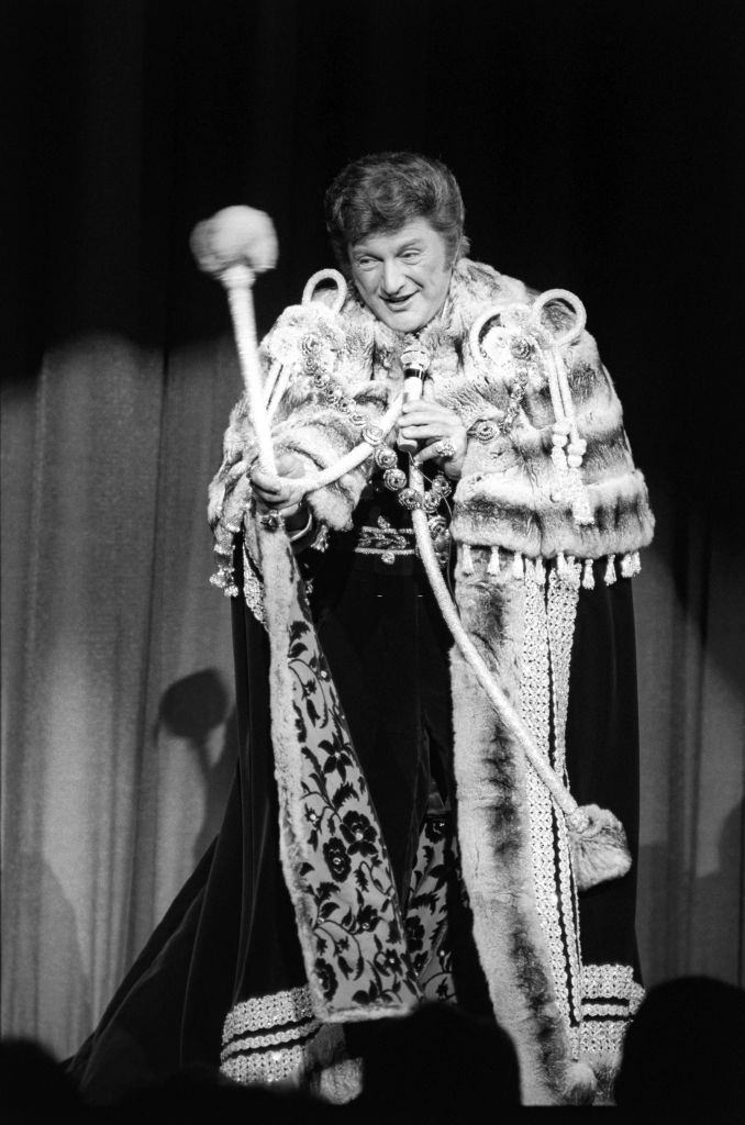 American musician and entertainer Liberace performs onstage, Las Vegas, 1980s.