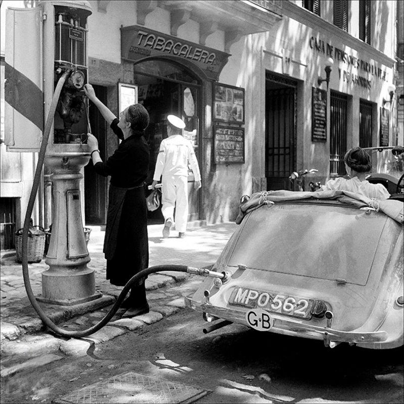 Woman refilling at a petrol station, 1956