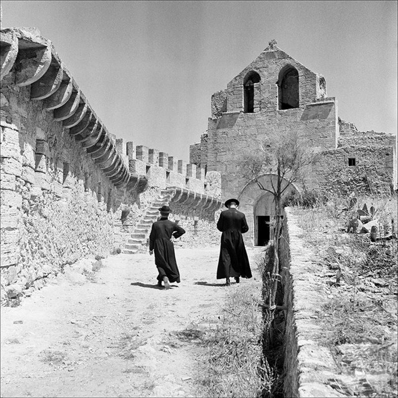 Two priests heading towards the oratory of Capdepera Castle, 1956