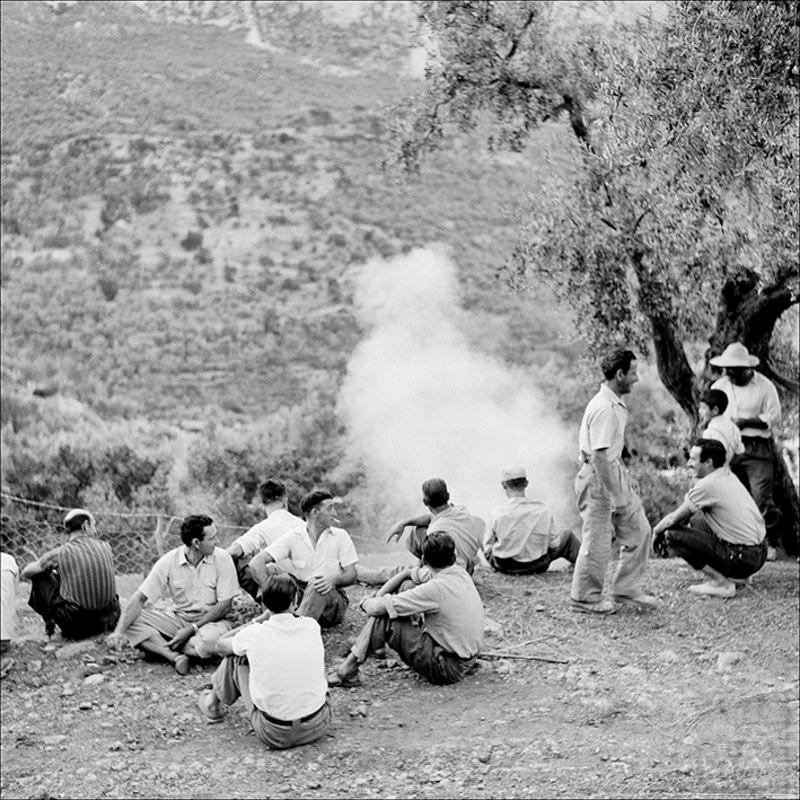 Group of men waiting at the Fornalutx bull's party, 1957