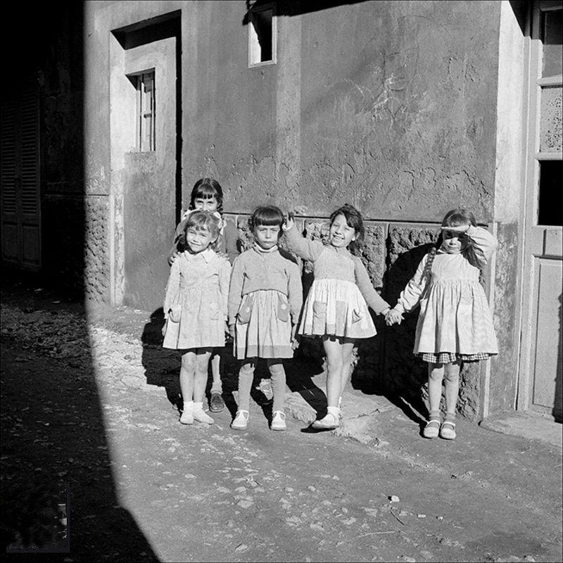 Group of dolls on a street in Palma, 1956