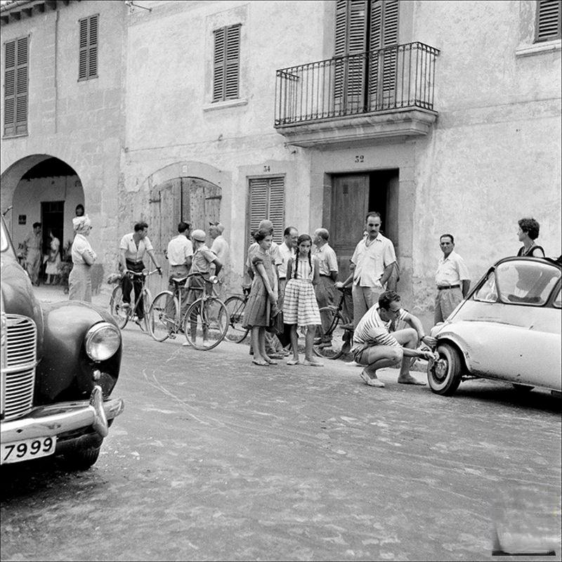 Group of people around a broken car, 1956