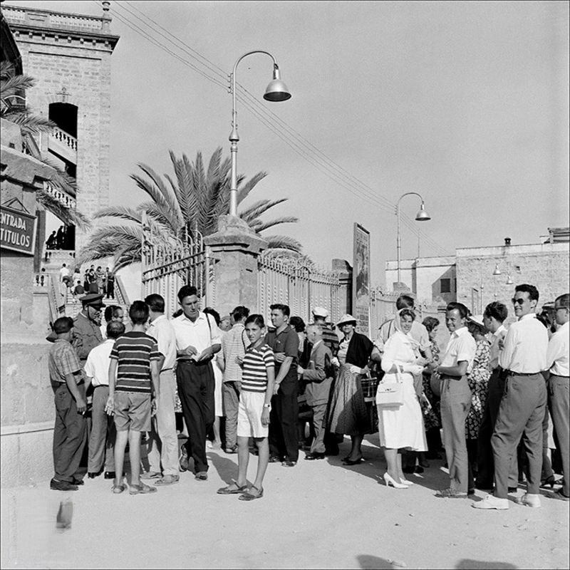 People at the entrance to the bullring in Palma, 1956