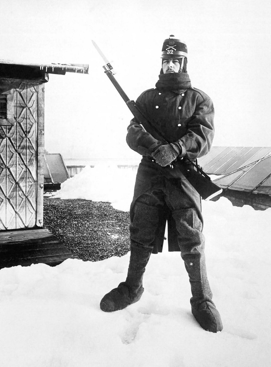 A Swiss soldier mans an army outpost in the high Alps where the war fighting between the Austrians and the Italians can be observed. 1918.