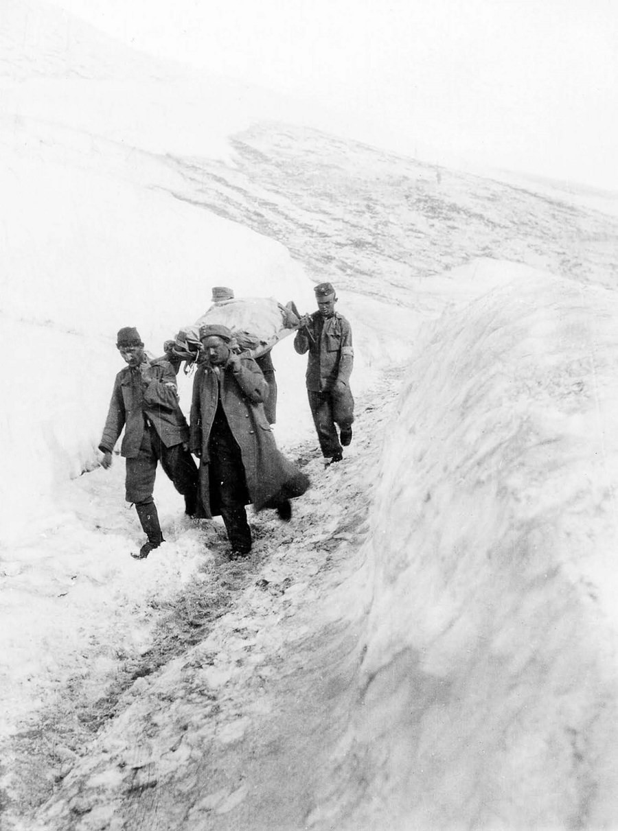 Austro-Hungarian soldiers carry a wounded comrade to a field hospital on Monte Nero. 1916.