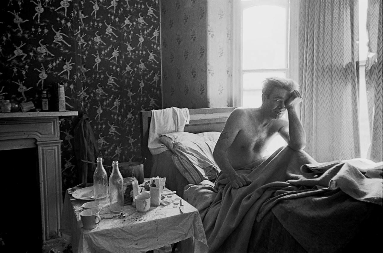 Single man living in one room of multi let house, Moss Side 1969