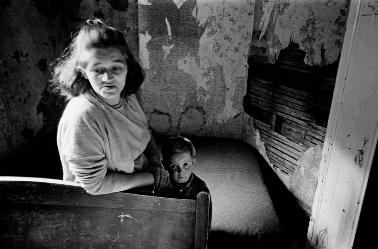 Mother and son in slum housing Manchester 1971