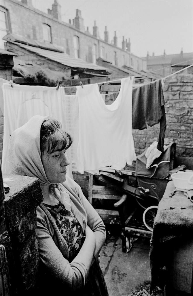 Housewife in backyard of Manchester terraced house, 1969