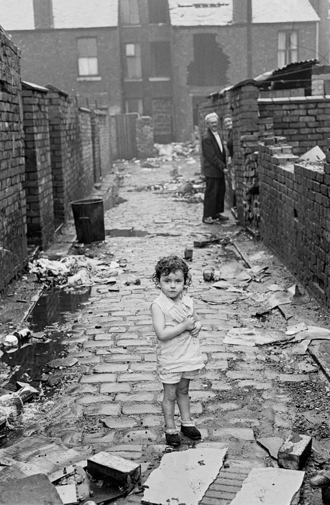 Child at end of alleyway, Manchester 1972