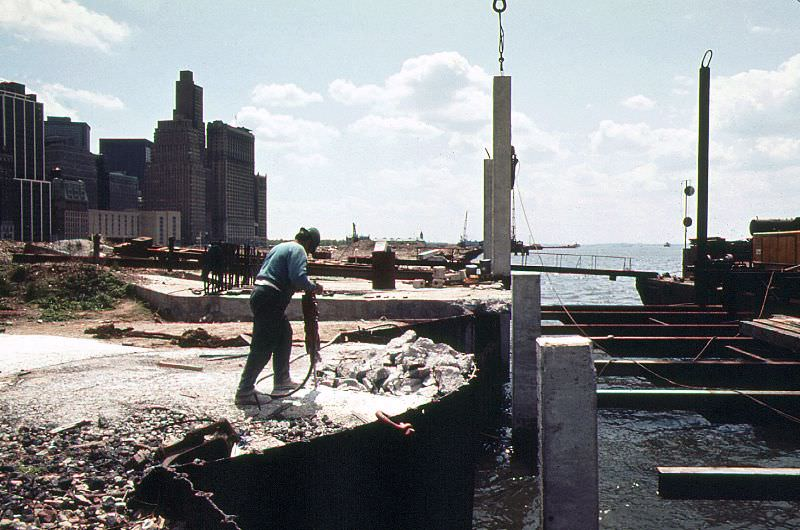 Battery Park City being built using land excavated from the World Trade Center construction site across West Street,April 1974