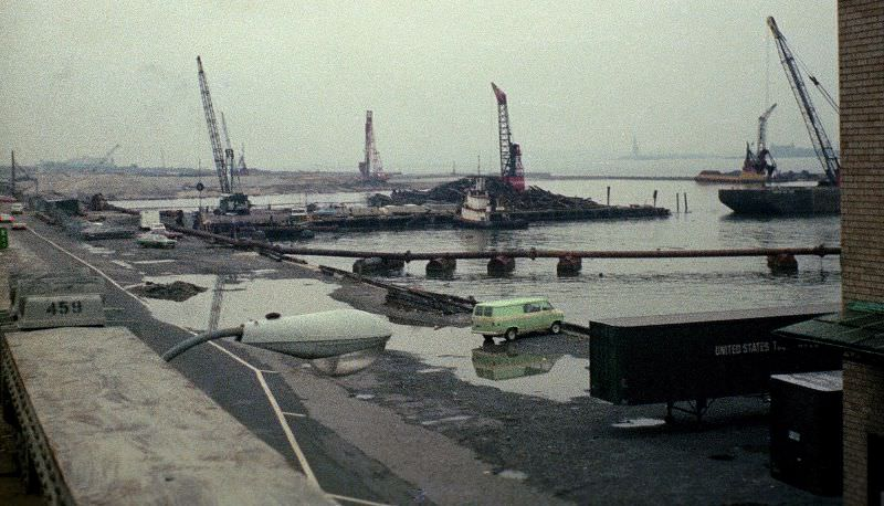 Battery Park City being created from soil dug out to build the World Trade Center, Statue of Liberty in the distance,March 1974