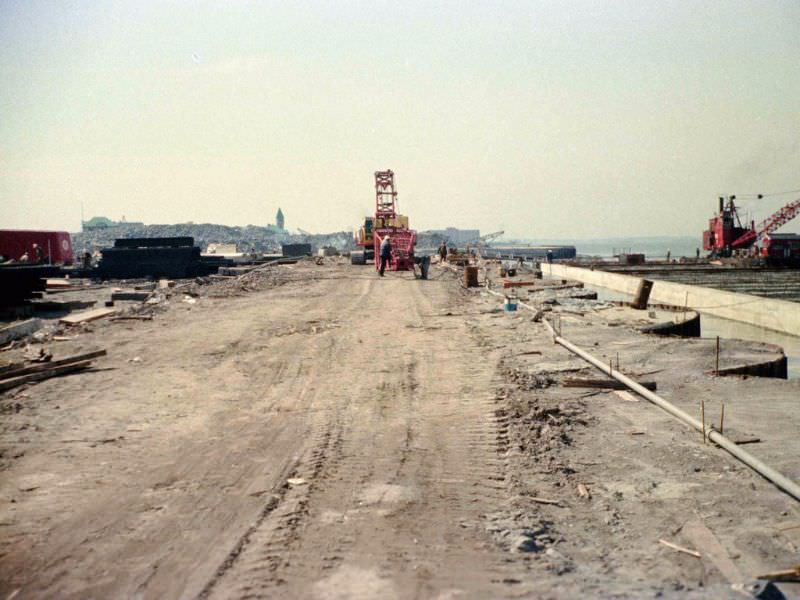 Battery Park City landfill edge by Hudson being constructed looking south to Pier A, 1974