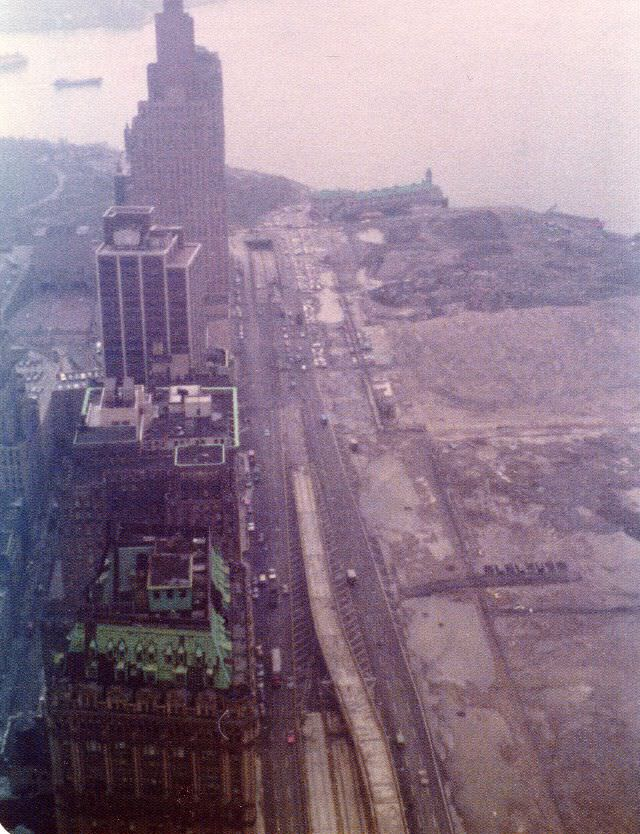 View from the 58th floor of the World Trade Center to the Battery Park City landfill, Pier A, end of the West Side Highway and New York Harbor on a foggy afternoon, March 1975
