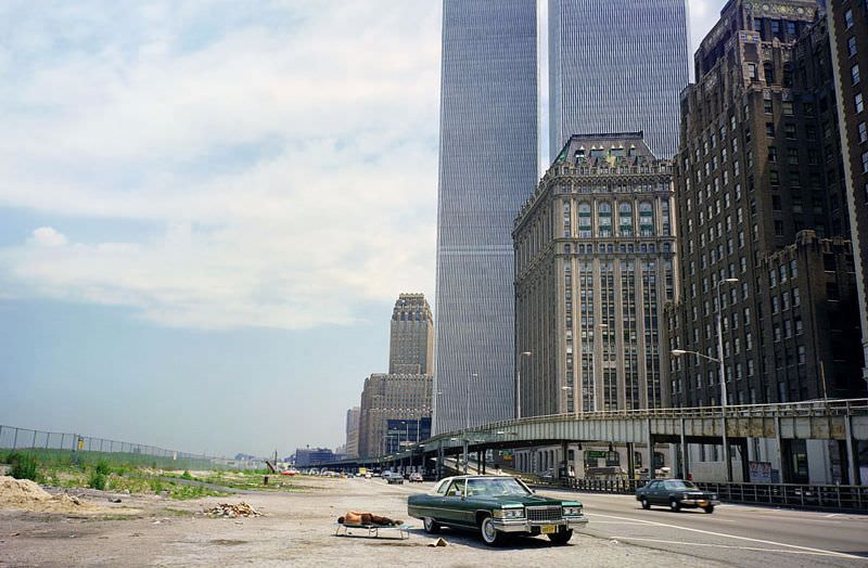 The swampy fields of future Battery Park City, The World Trade Center hovers, New York, August 1976