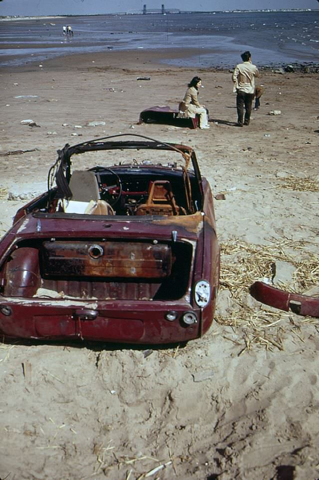 A lot of abandoned car chunks of a Triumph Spitfire at Plum Beach near Sheepshead Bay in Brooklyn, May 1973