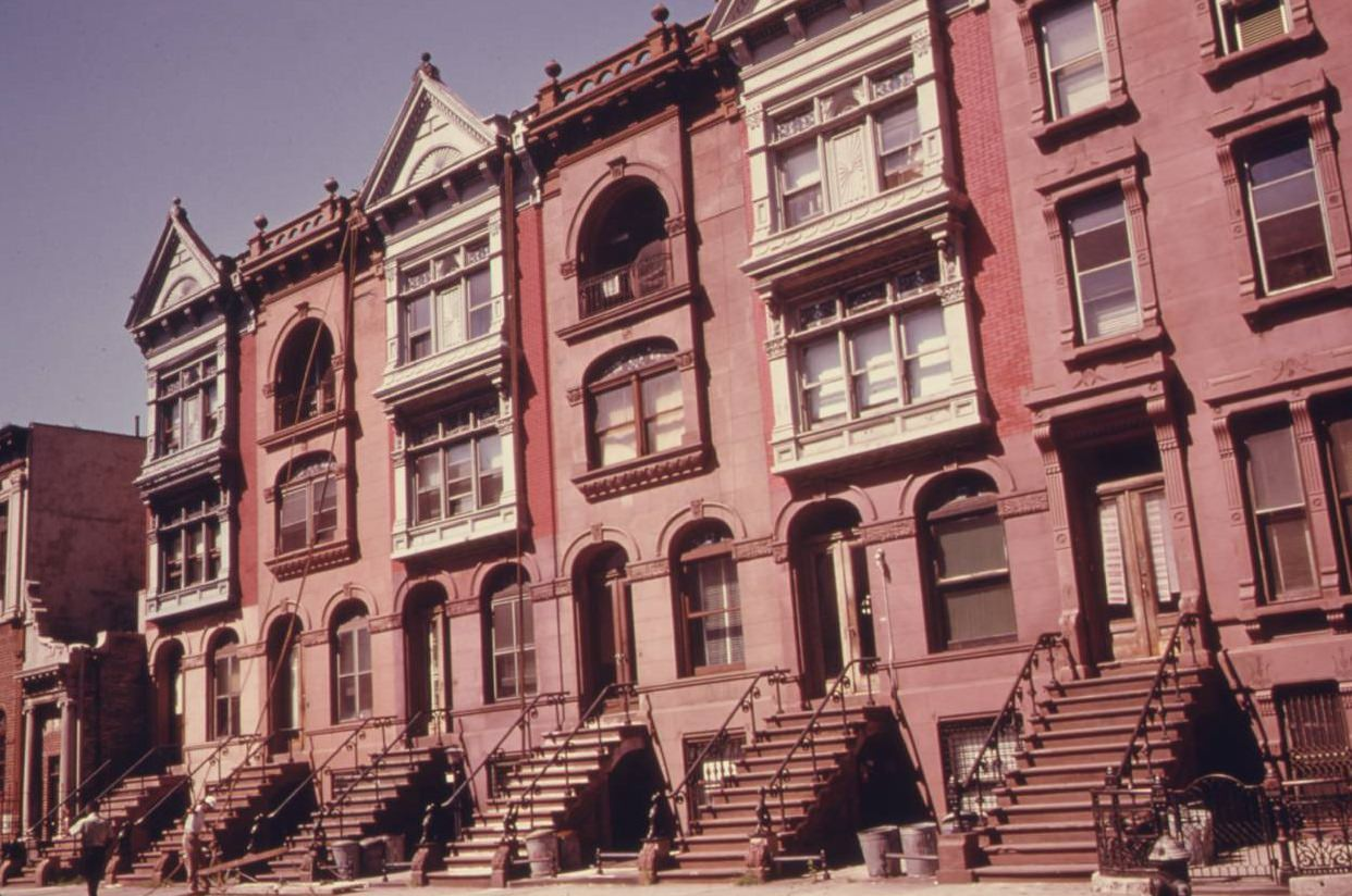 Turn of the century brownstone apartments being gentrified, Brooklyn, July 1974.