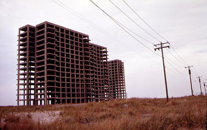 Breezy Point in Queens, New York near the Atlantic Ocean with the abandoned skeleton of an apartment building that was never finished, June 1973