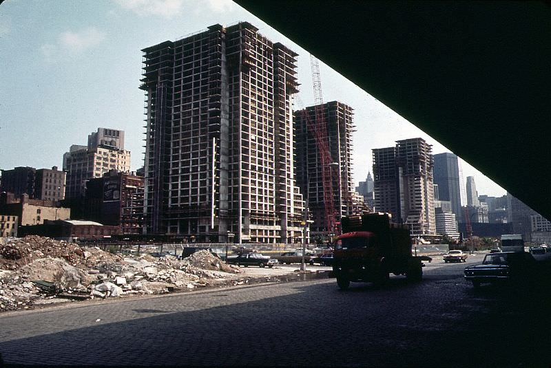 Construction of Independence Plaza North, cobblestoned West Street and Lower Manhattan from under the elevated West Side Highway, New York, June 1973