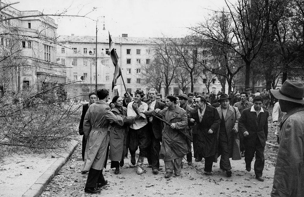 Member of the Hungarian secret police (AVH) surrounded by the enraged crowd during the revolt.  Budapest, November 1956
