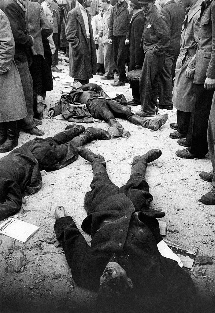 After the battle for the headquarters of the Communist Party, on the ground remain the bodies of Hungarian secret police agents (AVH).