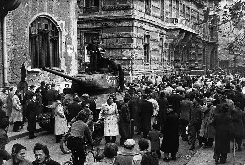Crowds surround a captured Russian tank during the anti-Communist revolution in Hungary.