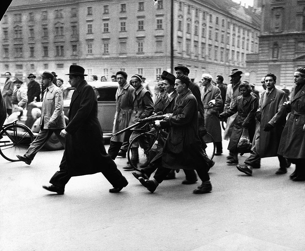 Hungarians arrest a member of the secret police during the revolution of 1956