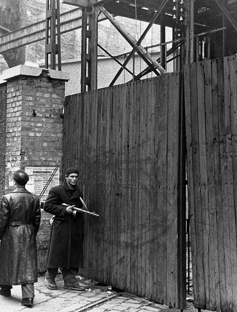 A worker keeps guard outside a striking factory during the 1956 anti communist revolution in Hungary.