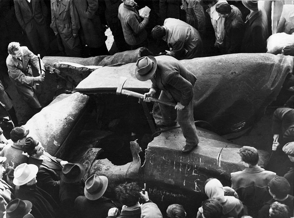 Giant statue of Stalin is chopped to pieces - near the National Theatre Budapest, 1956.