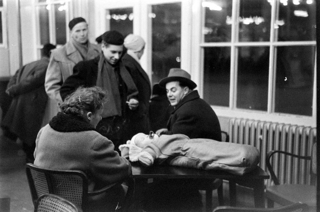Hungarian refugees talking at the relocation during the Hungarian Revolution, Hungary, 1956.