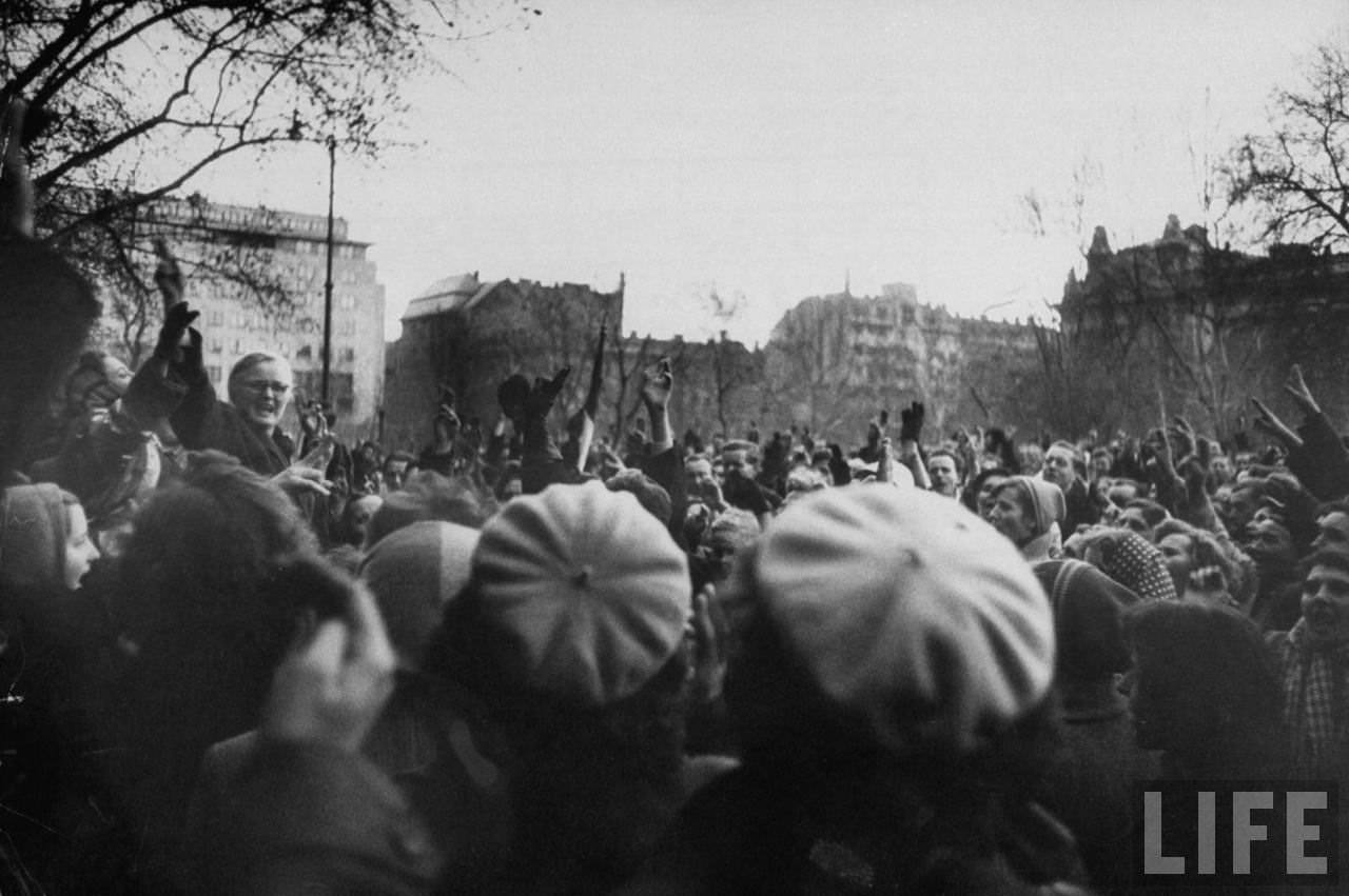Hopeful Hungarian rebel demonstrators during revolution against Soviet-backed regime.