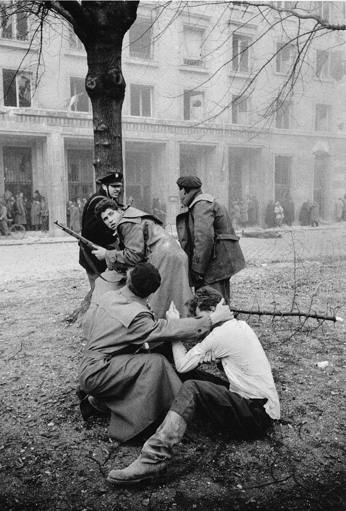 A member of the Hungarian secret police (AVH) has been captured by the enraged crowd during the revolt. Budapest, October 30, 1956