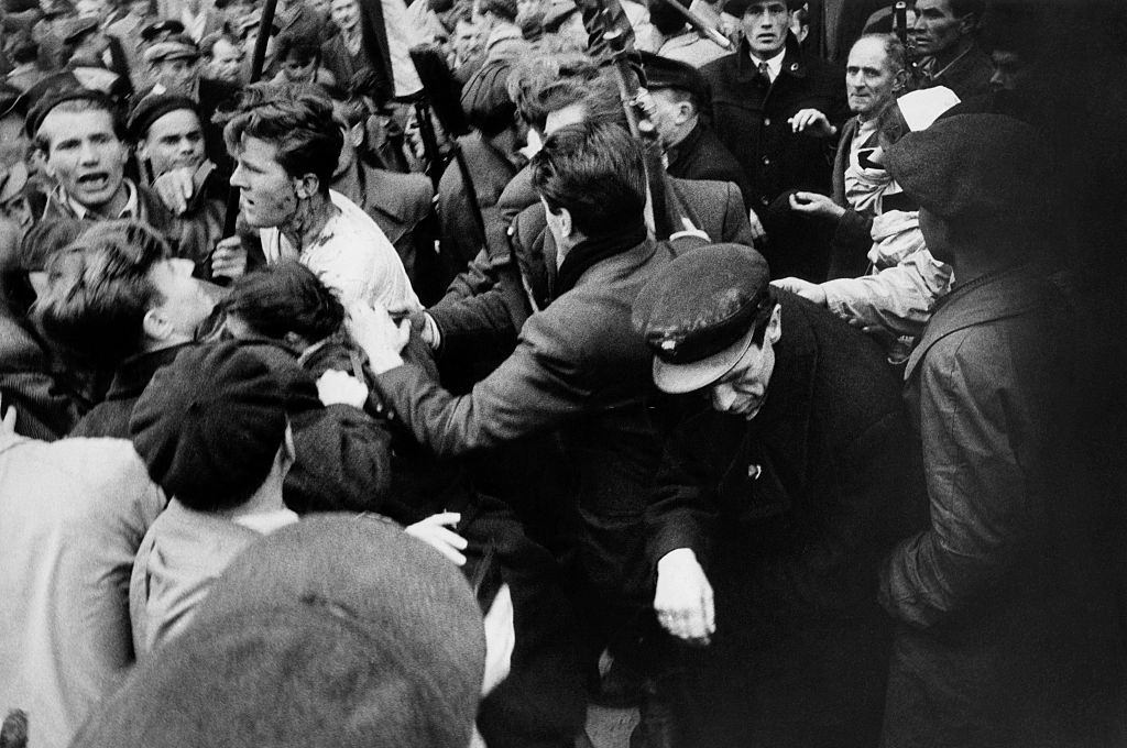 Member of the Hungarian secret police (AVH) surrounded by the enraged crowd during the revolt. Budapest, November 1956.