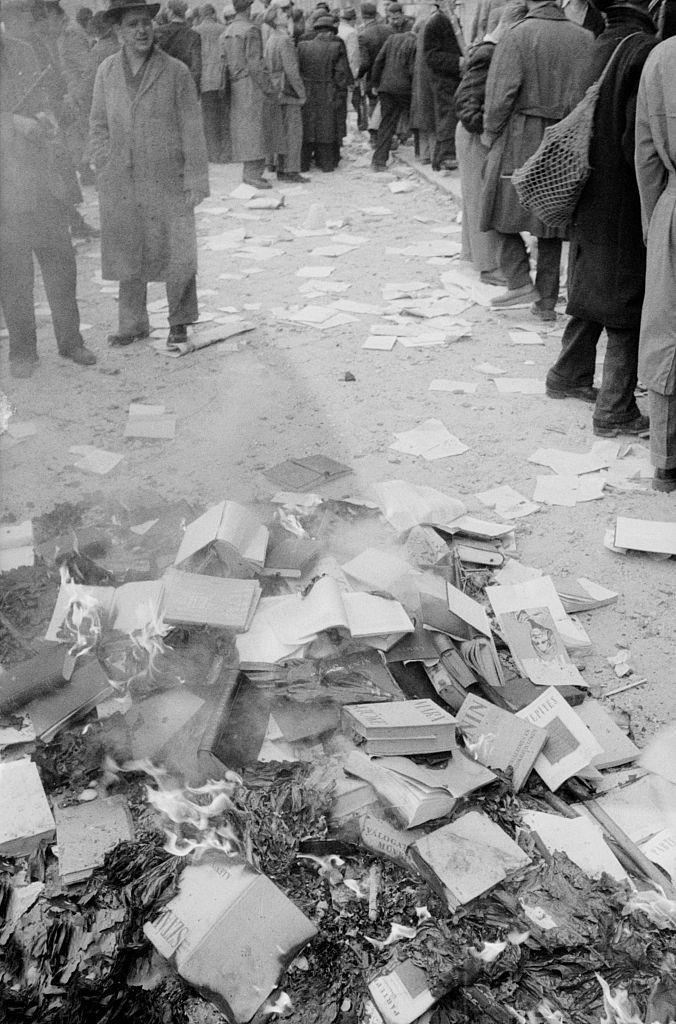 Rebels setting fire to Marxist books. Budapest, October 30, 1956.