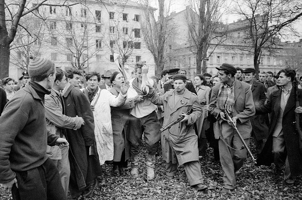 Injured officer of the Hungarian political police being caught by the rebels. Budapest, October 30, 1956.