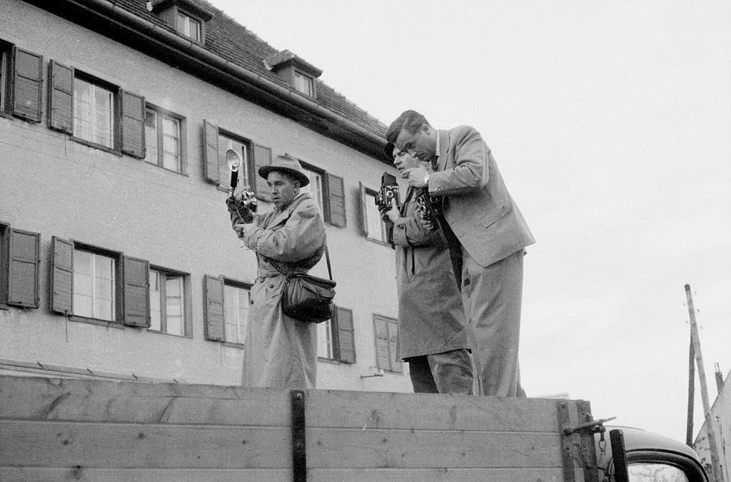 Three photographers on a van taking photos of the uprising. Budapest, 30th October 1956