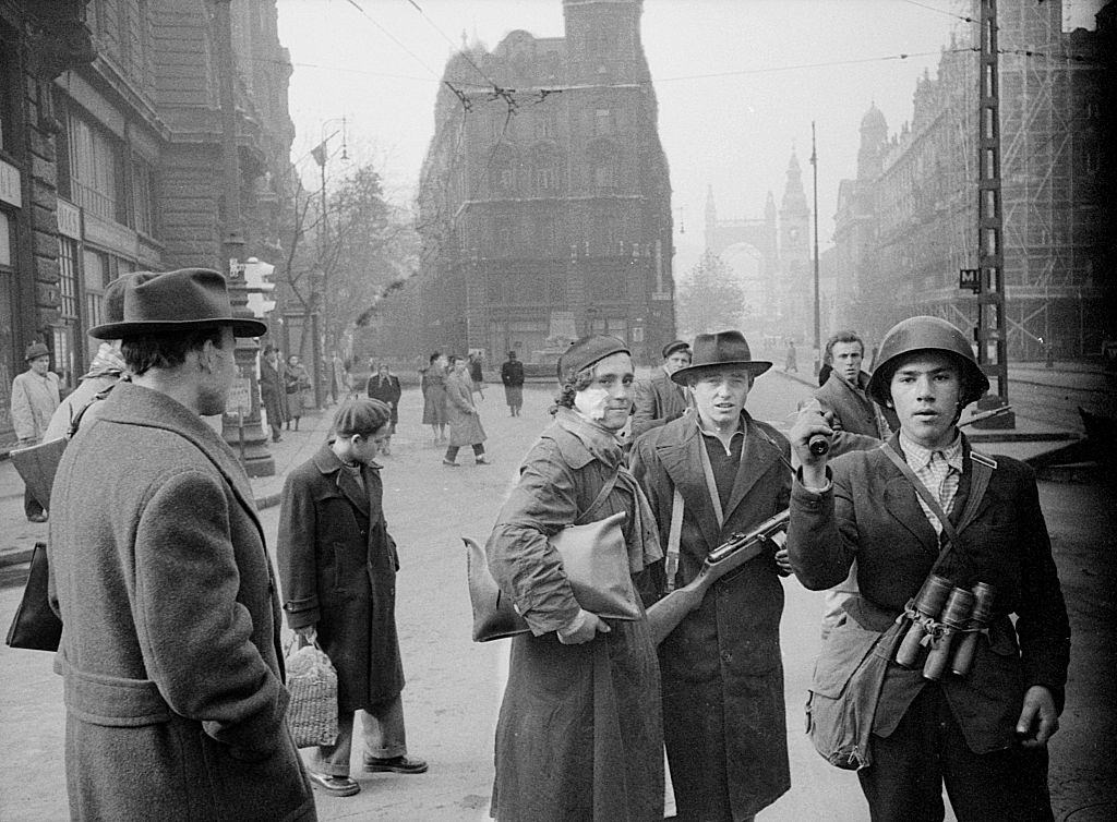 Two young revolutionaries in the streets of the city during the uprising against the Soviet regime.