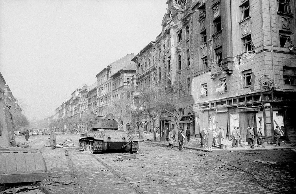 A panzer standing in a street of the capital destroyed by the fights.