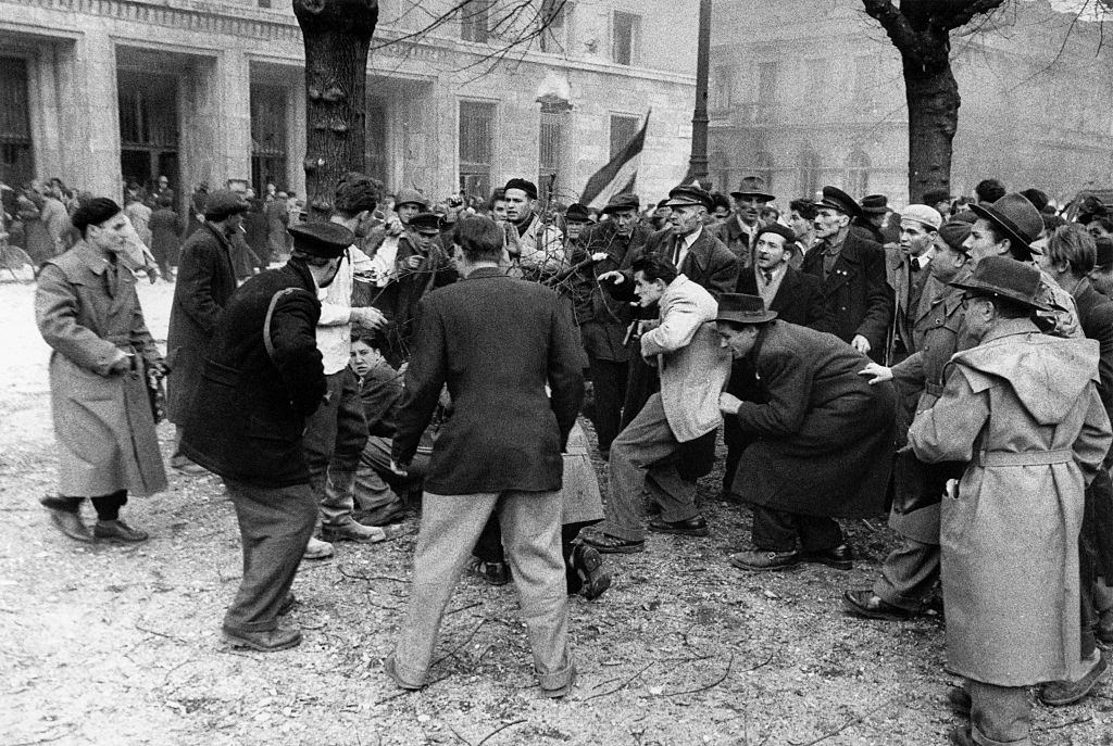 A member of the Hungarian secret police (AVH) is surrounded by the enraged crowd. Budapest, November 1956