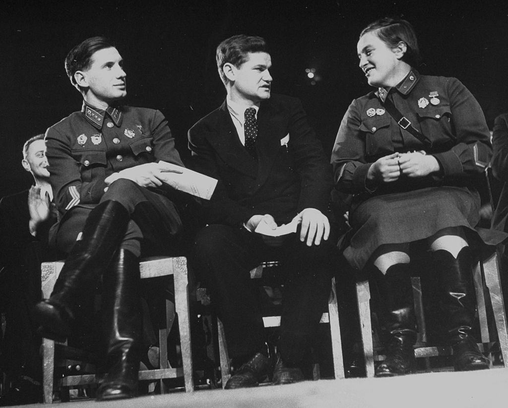 Lyudmila Pavlichenko talking with other Russian officers during celebration of Soviet Union's 25th anniversary, 1942.