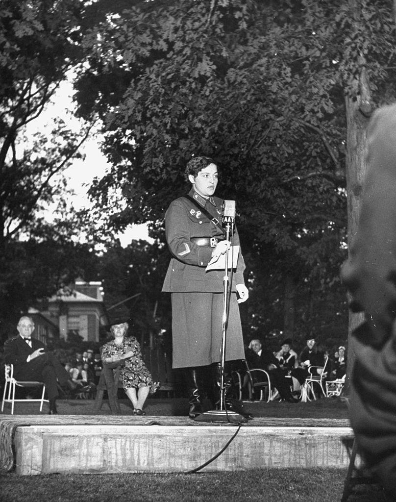 Lyudmila Pavlichenko addressing the guests at a party, 1942.