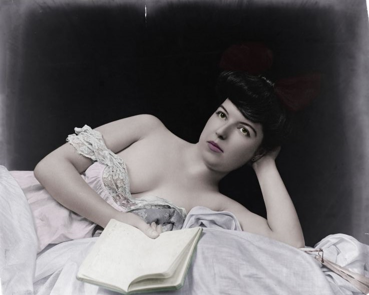 Young woman, wearing negligee lying on the bed