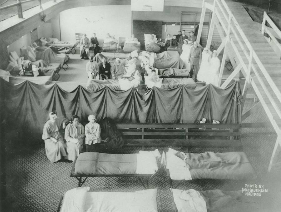 Volunteers tend to the wounded inside of a makeshift hospital set up in a commercial building.