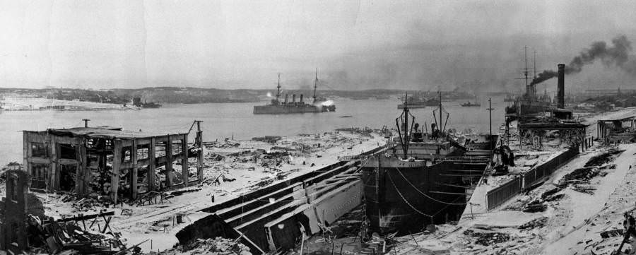 A pair of boats starts to move once more amid the devastation of Halifax Harbor.