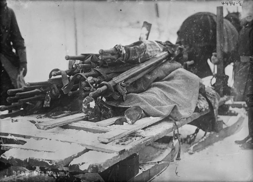 The dead are laid out on a sled and dragged away.