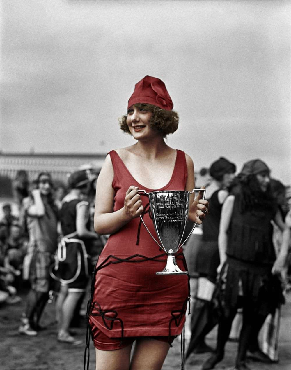 Miss Anna Neibel with her winners cup at the Washington Tidal Basin in 1922.