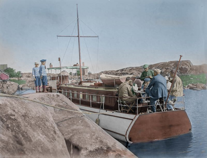 Morning coffee on the afterdeck, somewhere in the Finnish archipelago in 1920