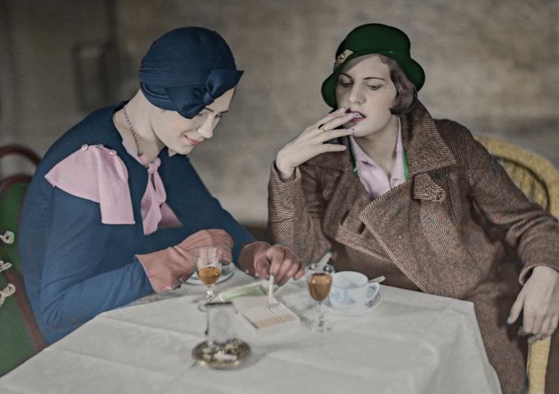 Two young ladies in Helsinki smoking and drinking cognac with coffee in the early 1930s