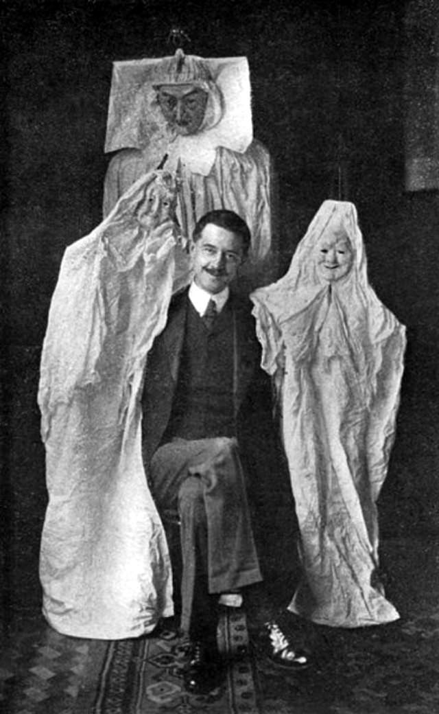 """Here, Marriott with some of the """"ghosts"""" that he bought from a catalog that sold tricks to phony spirit mediums."""